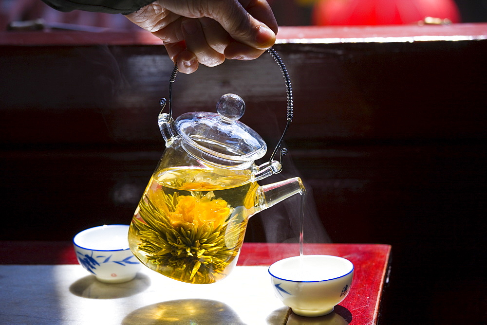 Flower infused tea being poured in the Huxinting Teahouse, Yu Garden Bazaar Market, Shanghai, China - 1161-3909