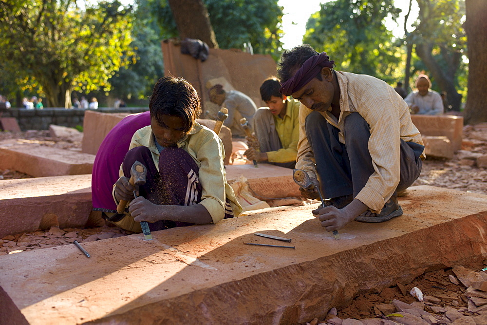 Stonemasons using traditional manual skills at stone workshop at Humayuns Tomb,  in New Delhi, India