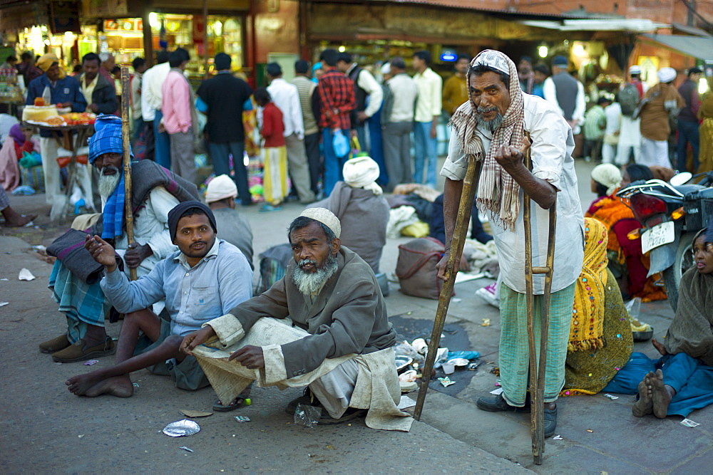 Indian beggars at muslim Meena Bazar, in Old Delhi, India
