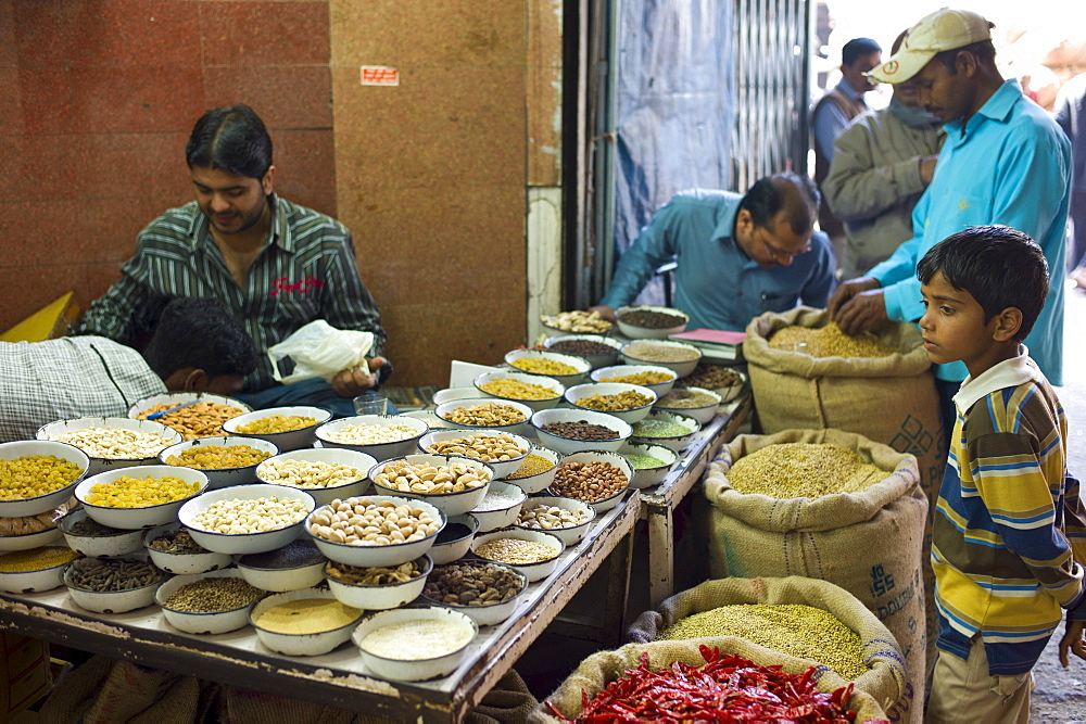 Red chillies, turmeric and other spices on sale at Khari Baoli spice and dried foods market, Old Delhi, India