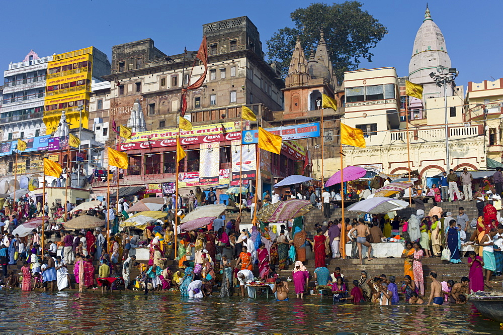 Indian Hindu pilgrims bathing in The Ganges River at Dashashwamedh Ghat in Holy City of Varanasi, Benares, India - 1161-4391