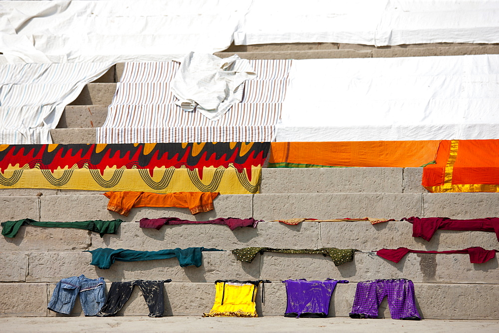 Laundry on the steps of the Ghats by The Ganges River at Kali Ghat in City of Varanasi, Benares, India
