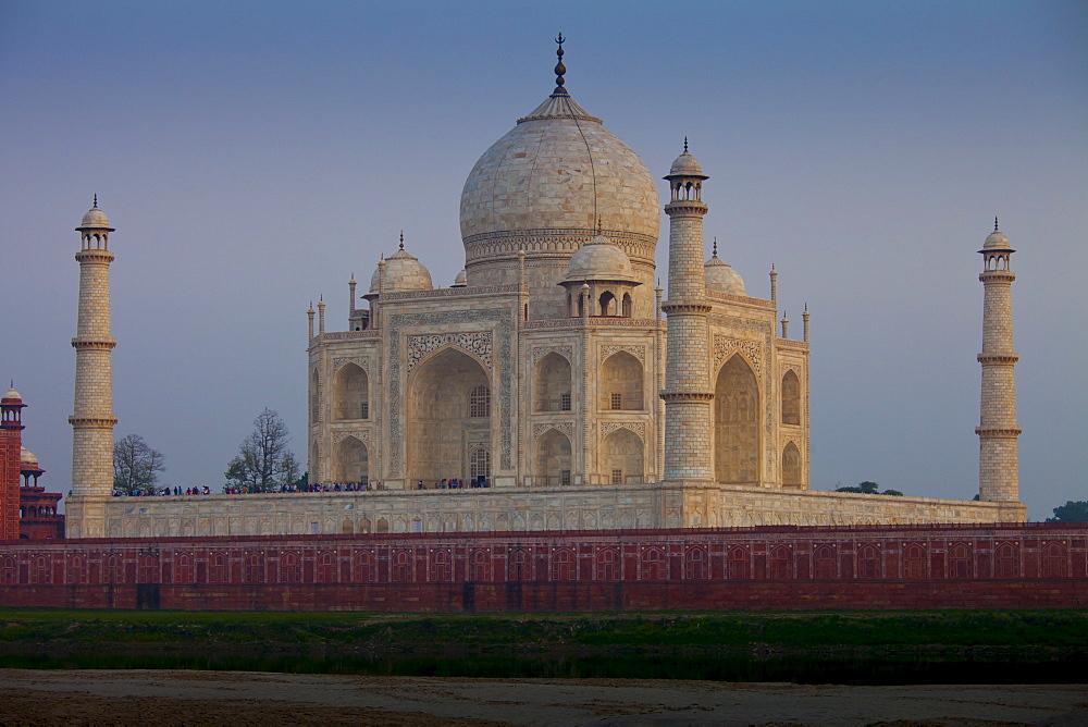 The Taj Mahal North Side viewed across Yamuna River at sunset , India