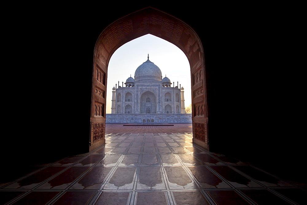 The Taj Mahal mausoleum western view (viewed from Taj Mahal Mosque with its prayer mat floor tiles) at dawn, Uttar Pradesh, India