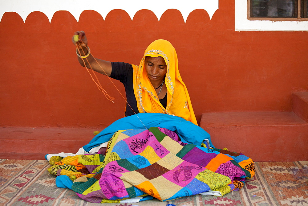 Indian woman sewing textiles at Dastkar women's craft co-operative, the Ranthambore Artisan Project, in Rajasthan, Northern India - 1161-4828