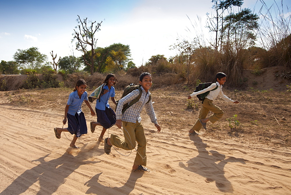Indian schoolboys and girls walking to school at Doeli in Sawai Madhopur, Rajasthan, Northern India - 1161-4888