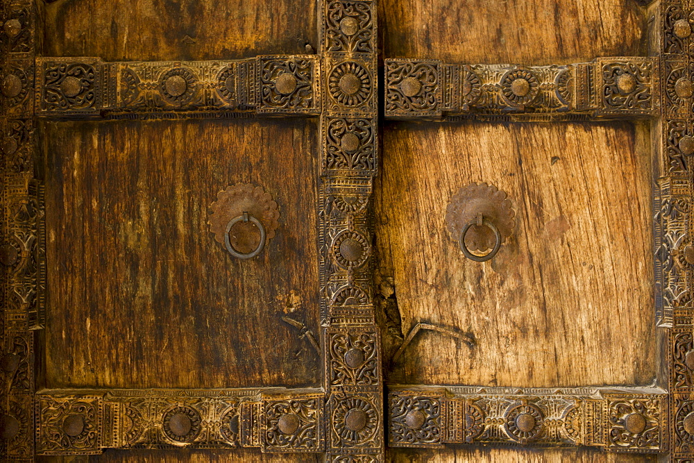 Hindu style traditional door in Acacia wood at the 16th Century Amber Fort in Jaipur in Rajasthan, Northern India