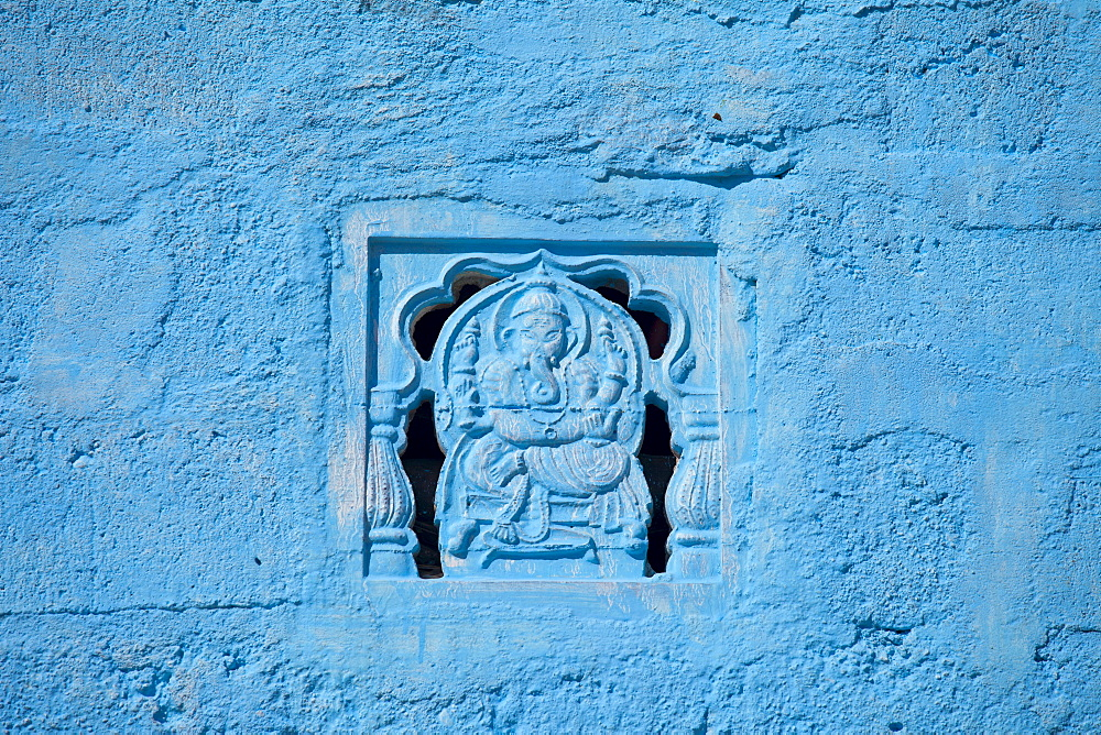 Traditional blue painted home in Hindu Brahman high caste village of Dhudaly  in Rajasthan, Northern India