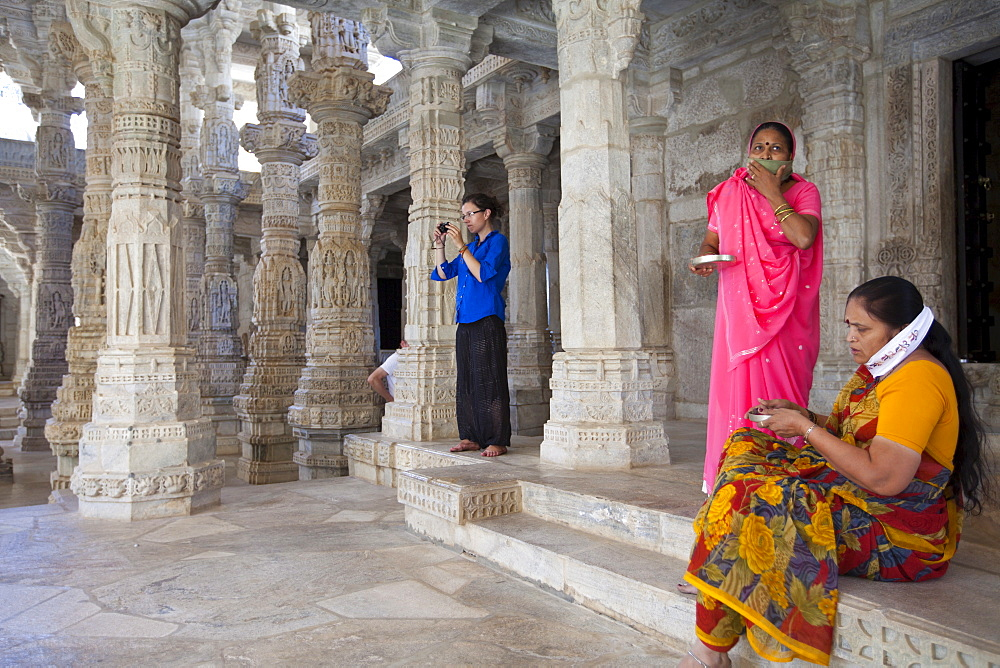 Jain pilgrims with traditional masks at The Ranakpur Jain Temple at Desuri Tehsil in Pali District, Rajasthan, India