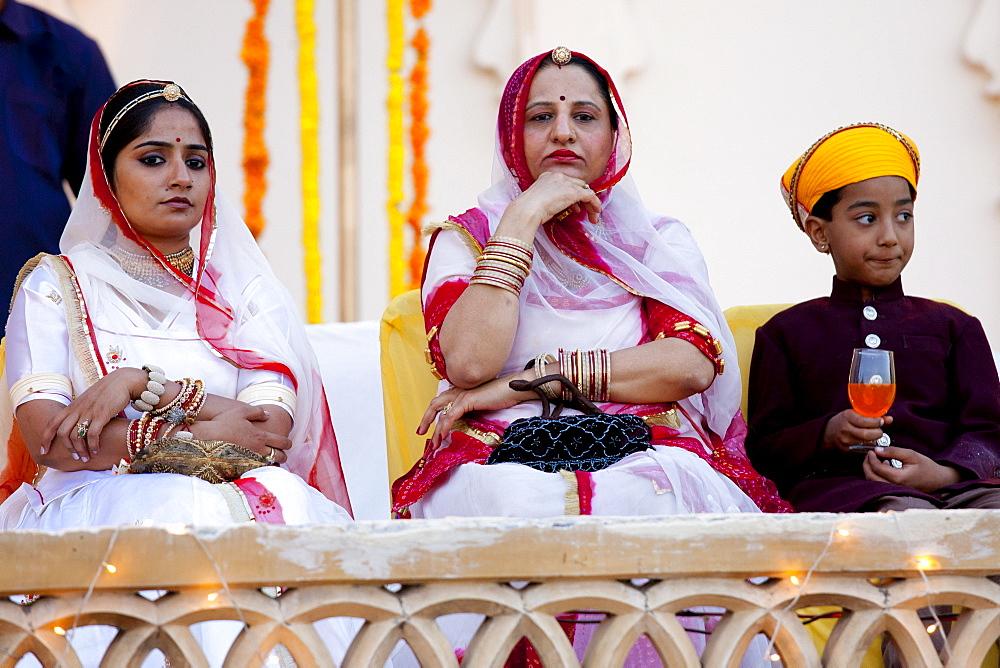 Royal Family guests from the feudal family of Karjali at Holi festival of 76th Maharana of Mewar, His Highness, Shriji Arvind Singh Mewar of Udaipur, at the City Palace, Rajasthan, India (left to right: Sidhi Kumari, Karuna Kunwar, Bahv Vaibhav Singh)