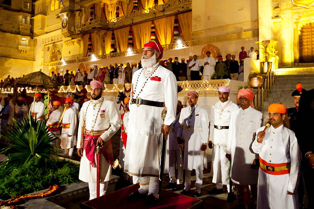 Shriji Arvind Singh Mewar of Udaipur, 76th Custodian of the House of Mewar, presides at annual Hindu Holi Fire Festival at The Zenana Mahal in the City Palace, Udaipur, Rajasthan, India. On his right is son  Lakshyaraj Singh Mewar of Udaipur, Maharaj Kumar.