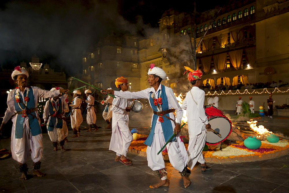 Traditional Ger dancers at The Maharana's City Palace for annual Hindu Holi Fire Festival by The Zenana Mahal, Udaipur, Rajasthan, India.