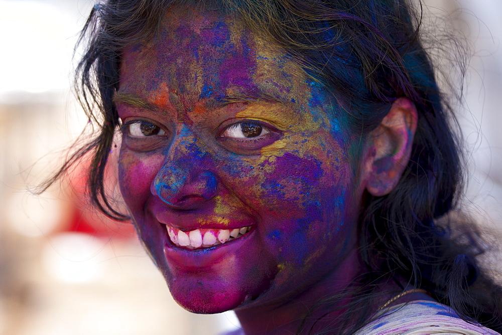 Indian woman celebrating annual Hindu Holi festival of colours with powder paints in Mumbai, formerly Bombay, Maharashtra, India - 1161-5290