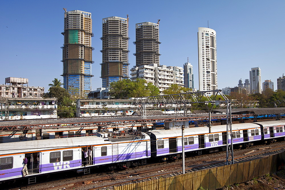 High rise developments by Mahalaxmi Station and the Western Railways train of the Mumbai Suburban Railway, India