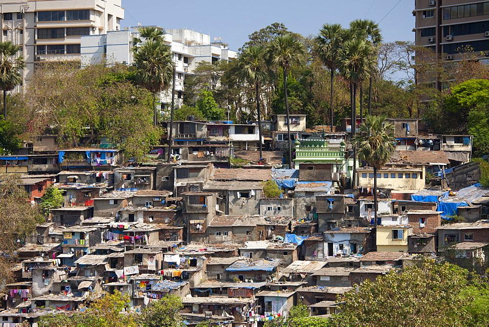 Slum housing and slum dwellers next to apartment blocks in Bandra area of Mumbai, India from Bandra Worli Sealink Road