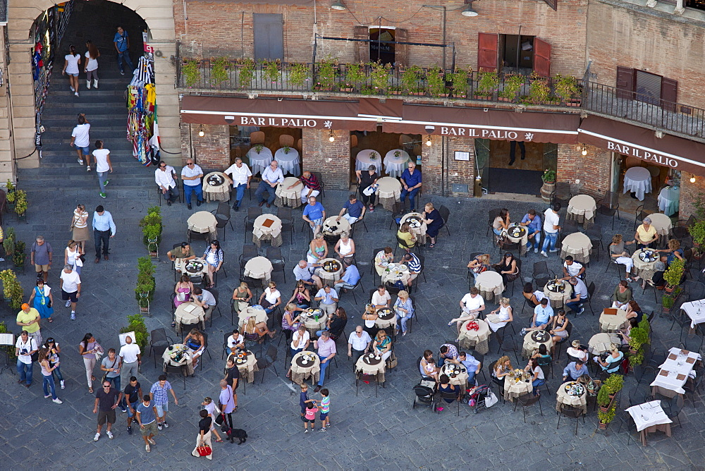 Aerial view from Il Torre, clock tower of diners at Bar Il Palio in Piazza del Campo, Siena, Italy