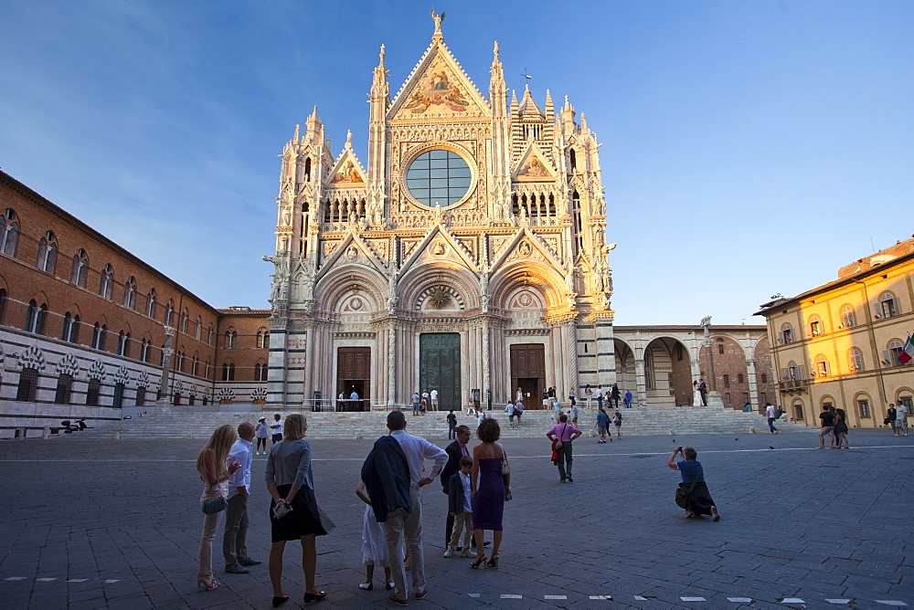Tourists visit Il Duomo di Siena, the Cathedral of Siena, Italy