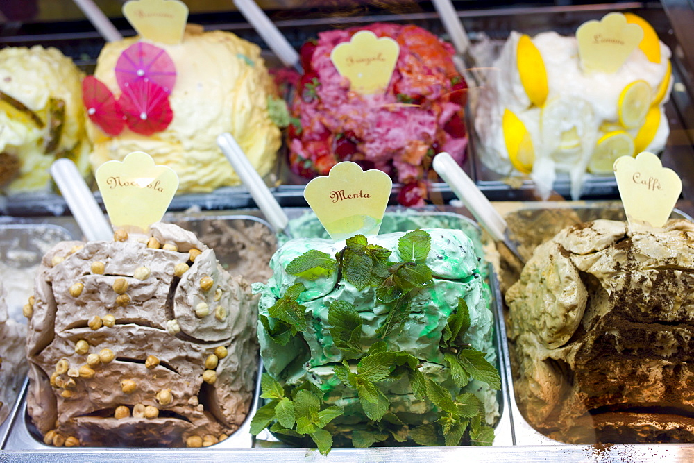 Gelato ice cream shop selling mint, hazlenut, coffee, lemon, strawberry flavours in Siena, Italy