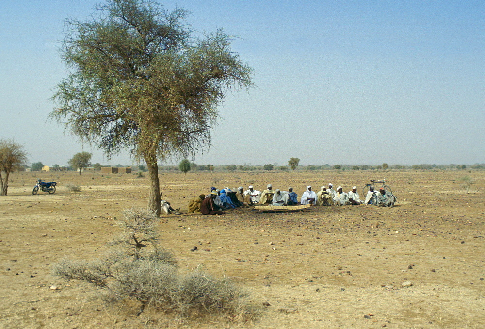 Villagers gather for a funeral in the desert in Burkina Faso (formerly Upper Volta)