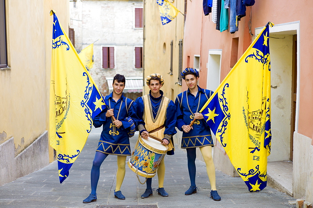 Members of the Corso Contrada in livery costumes for traditional parade in Asciano, inTuscany, Italy