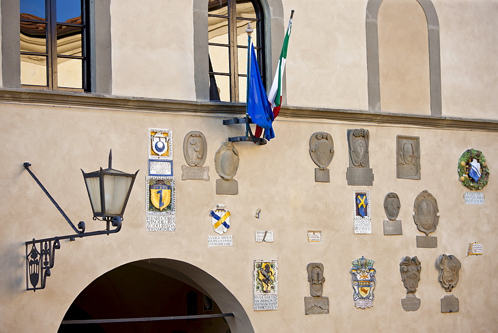 Badge crests on the Town Hall, The Palace of the Podesta, in Piazza Francesco Ferrucci, Radda-in-Chianti, Tuscany, Italy