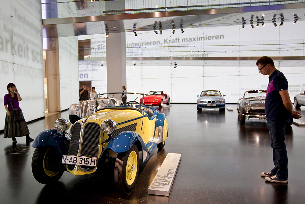 Visitor at BMW Museum views BMW 315 1934 model car on display at the BMW Headquarters in Munich, Bavaria, Germany