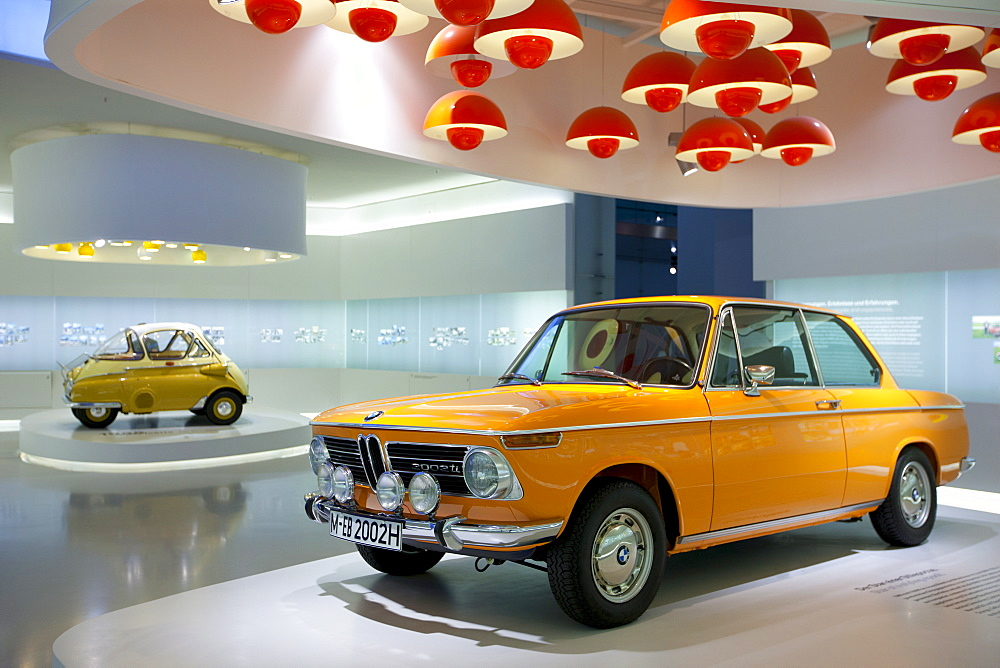 BMW 2002 TI car and Bubble Car Isetta 1955 on display at the BMW Museum and Headquarters in Munich, Bavaria, Germany