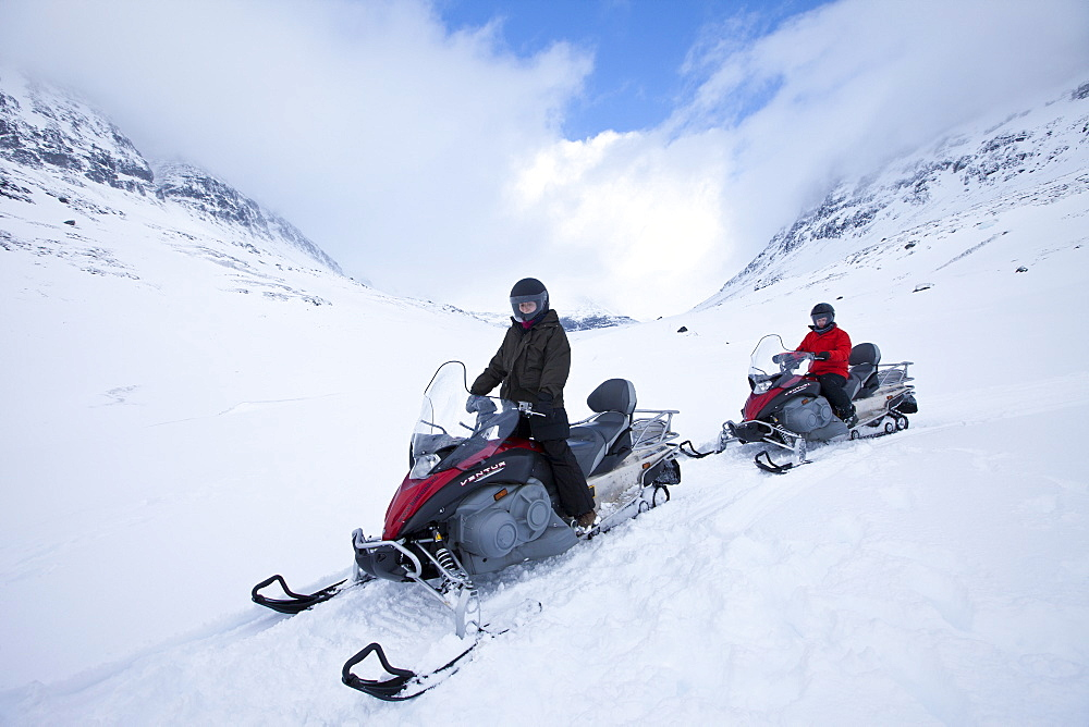 Snowmobiling in the arctic alps in the Arctic Circle near Holt in the region of Tromso, Northern Norway