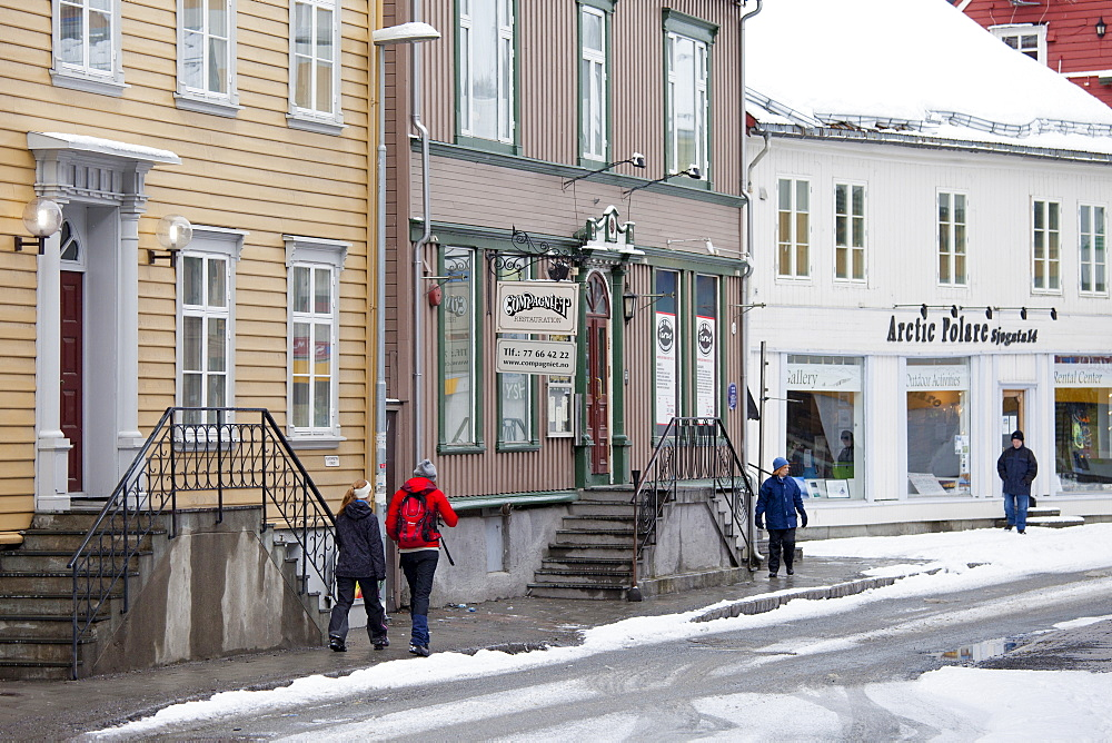 Street scene Fiske Compagniet Restauration restaurant and Arctic Polare shop in Storgata in Tromso, Arctic Circle, Northern Norway
