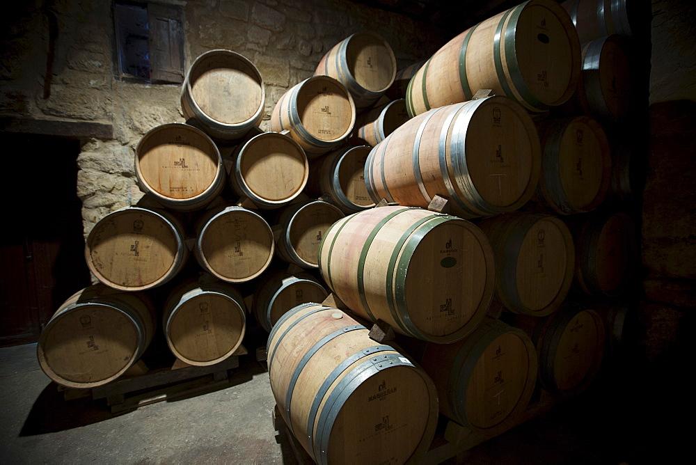 Rioja wine in American oak barrels in cave at Bodegas Agricola Bastida in Rioja-Alaveda area of Basque country, Spain