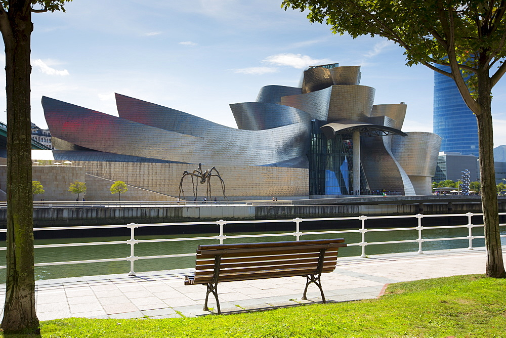 Architect Frank GehryÕs Guggenheim Museum futuristic design from across River Nervion at Bilbao, Basque country, Spain
