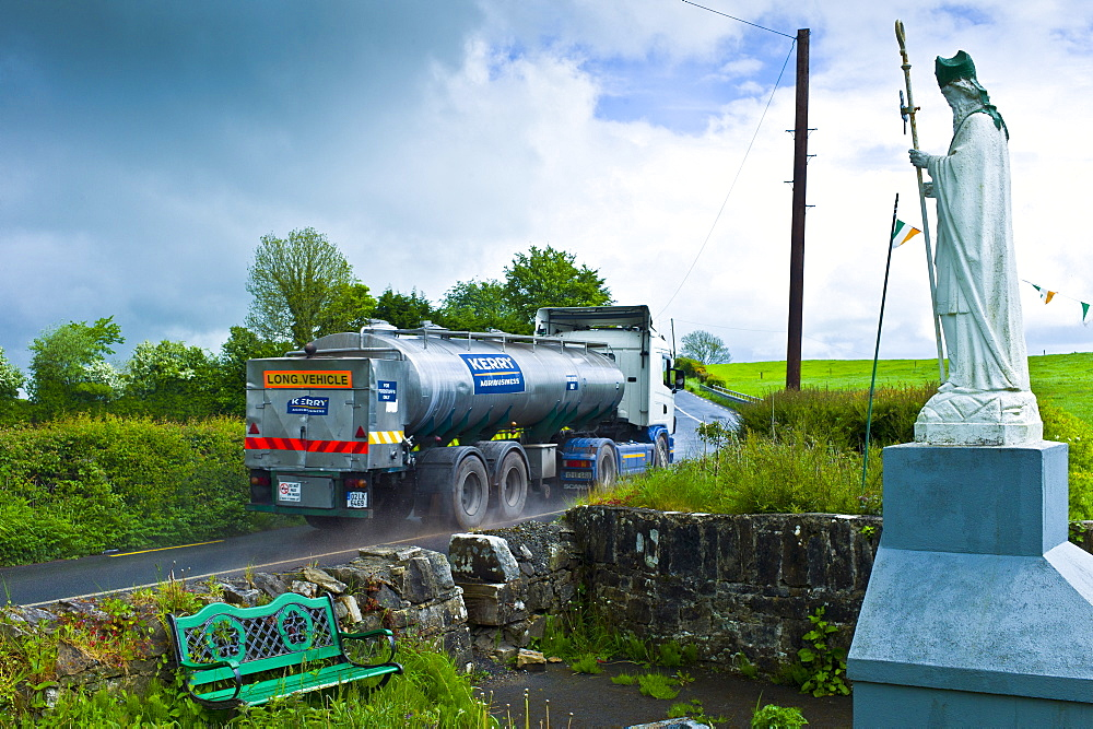 Milk tanker lorry passes religious shrine of Irish patron saint St Patrick in Ballingarry, County Limerick, Ireland