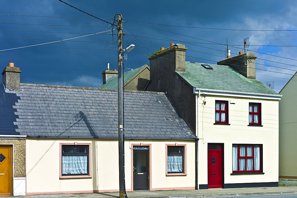 Street scene pastel painted terraced homes in Kilkee, County Clare, West of Ireland