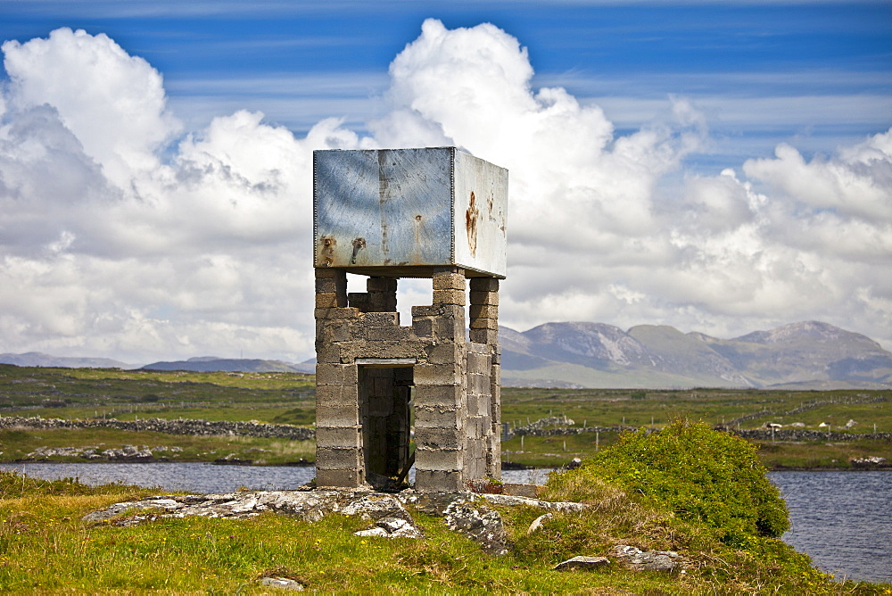 Primitive water tower in the Connemara landscape, County Galway