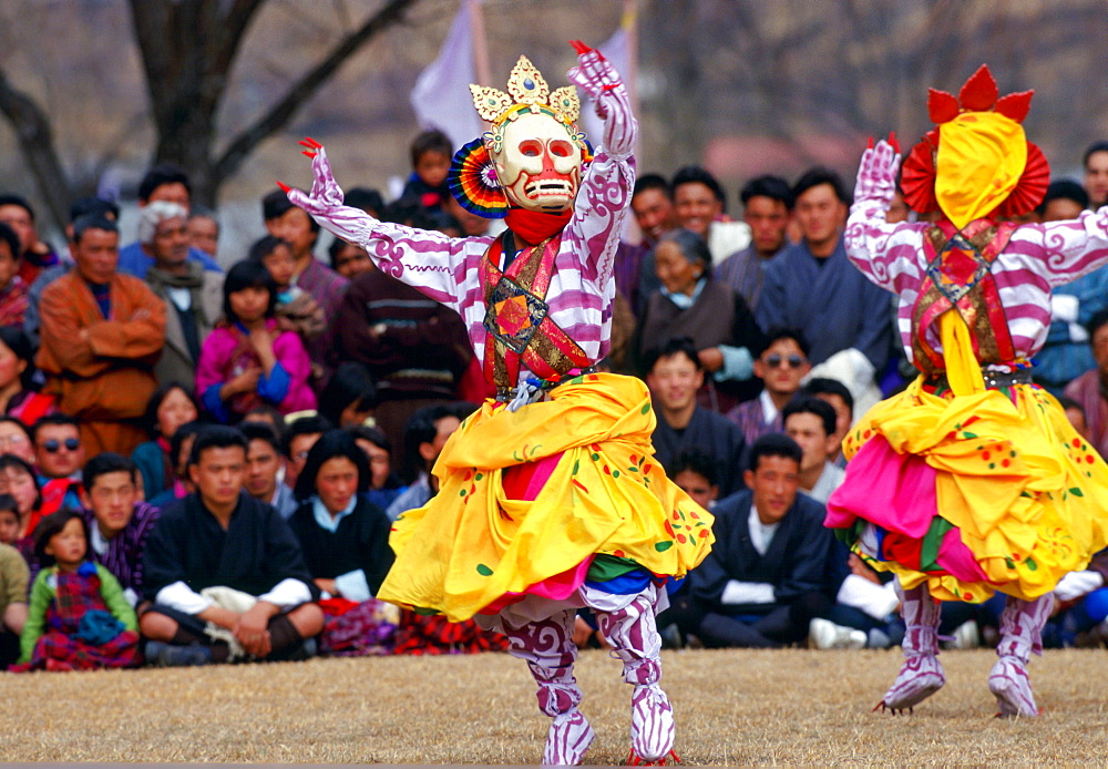 Masked dancers of the Royal Troupe perform Skeleton Dance, Paro, Bhutan