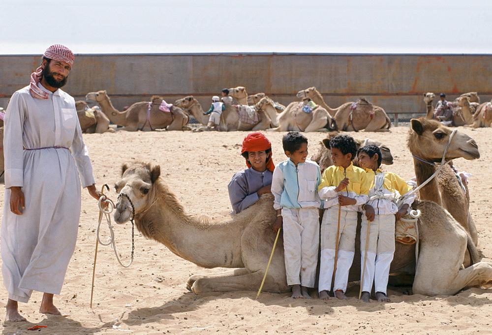 Camel racing with boy jockeys at Al Ain in Abu Dhabi, United Arab Emirates, Middle East