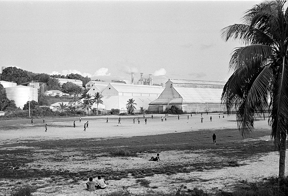 Locals playing football at phosphate (fertiliser) works on the island of Nauru in the South Pacific