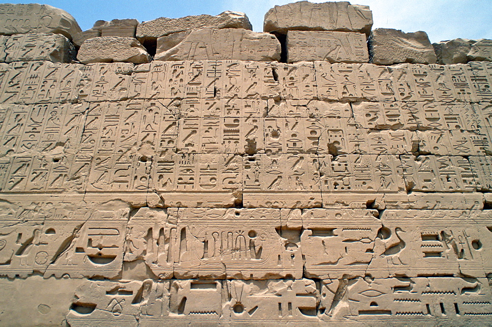 Ancient inscriptions on a wall in the Great Hypostyle Hall, Karnak Temple, Luxor, Egypt