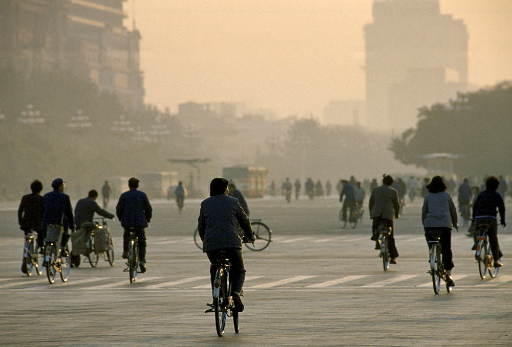 Chinese people using traditional bicycles for commuting around Tiananmen Square in Peking now Beijing, China in the 1980s