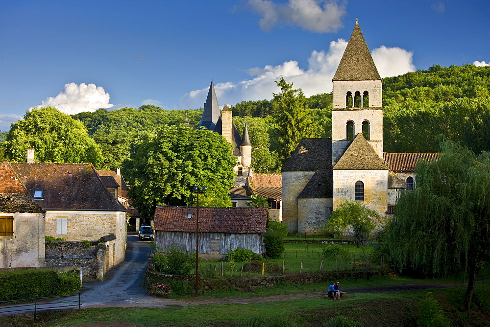 Courting couple in the village of St Leon sur Vezere in the Dordogne, France