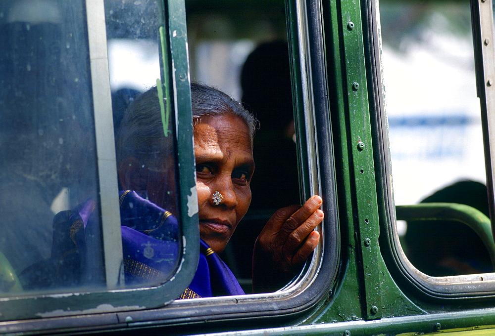 Woman bus passenger, Calcutta, India