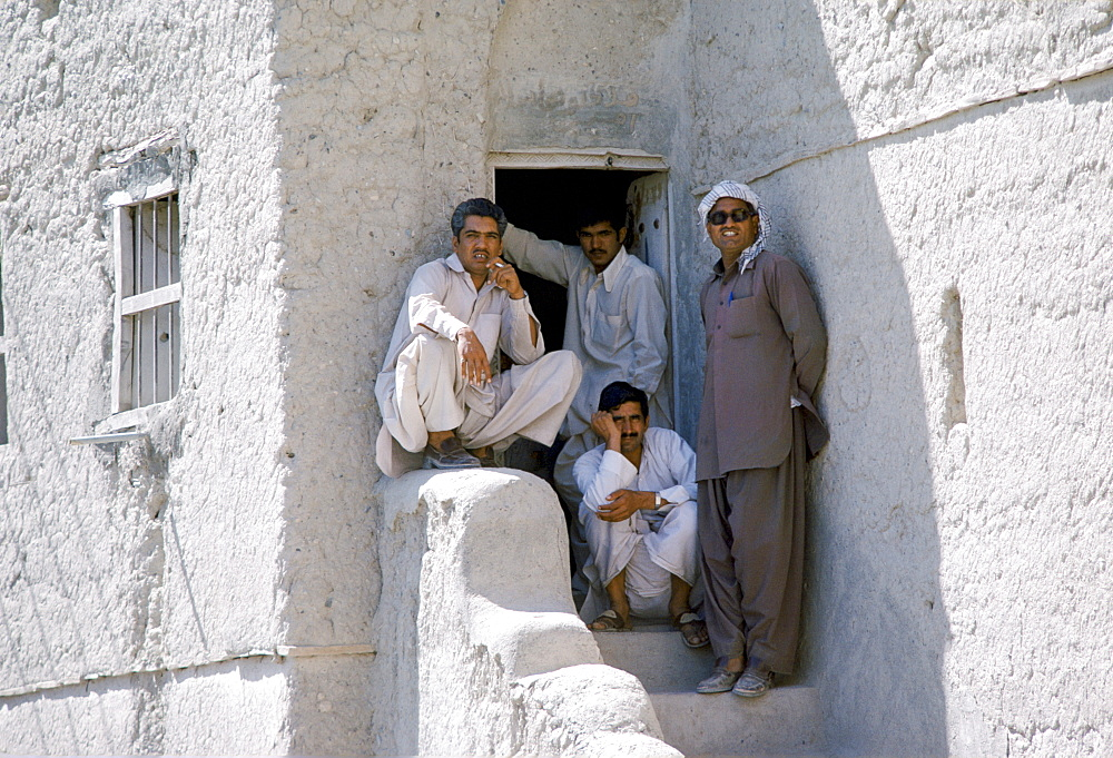 Young men in traditional clothing at Nizwa in Oman, Middle East