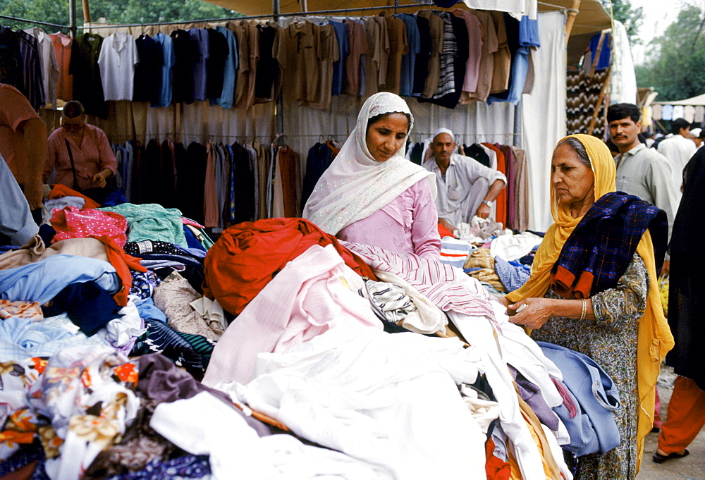 Pakistani women shopping for clothes in the souk in Islamabad, Pakistan