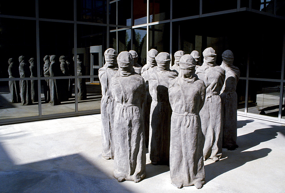 "The ""Petrified"" a group of shrouded, life-size figures by Swiss artist Carl Bucher denouncing the violation of human rights at the entrance of the Museum of the International Red Cross in Geneva, Switzerland"