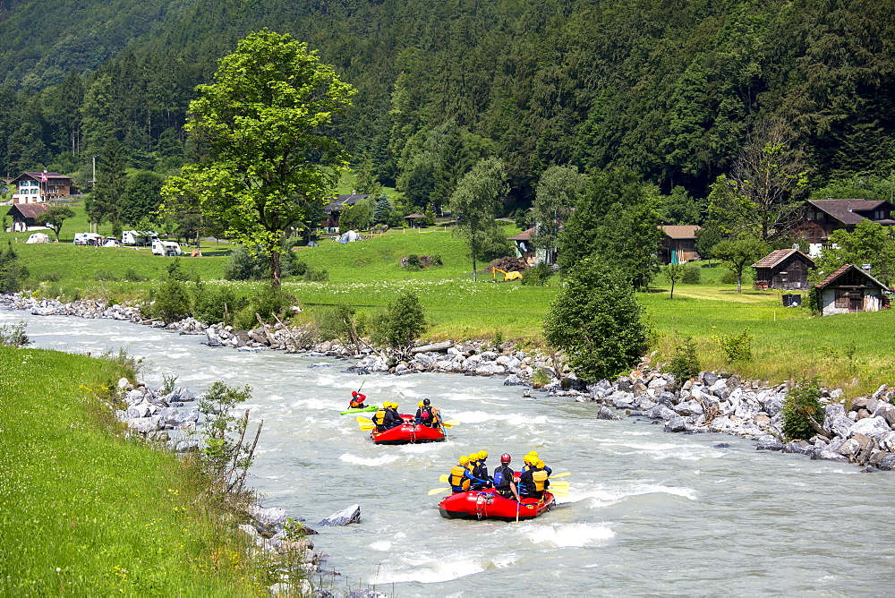 Tourists white water rafting towards Interlaken in the Bernese Oberland, Switzerland, Europe