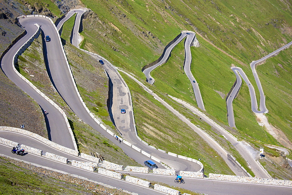 Cars on The Stelvio Pass (Passo dello Stelvio) (Stilfser Joch), on the route to Prato, in the Eastern Alps in Northern Italy, Europe