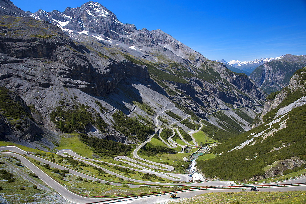 Motorcycles on The Stelvio Pass (Passo dello Stelvio) (Stilfser Joch), on the route to Bormio, in the Eastern Alps in Northern Italy, Europe