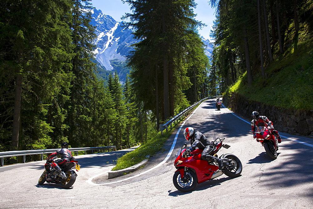 Motorcycles on The Stelvio Pass (Passo dello Stelvio) (Stilfser Joch), route from Bormio to Trafio in The Alps, Italy, Europe
