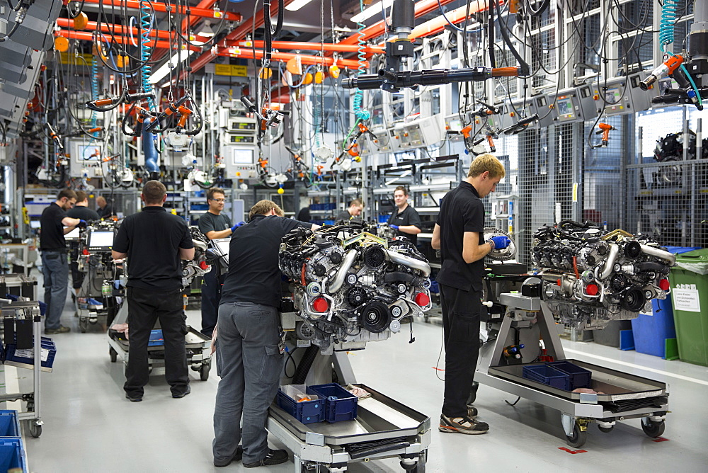 Engineers at work each hand-building an M157 5.5L V8 biturbo engine, Mercedes-AMG engine production factory in Affalterbach, Bavaria, Germany, Europe - 1161-8346