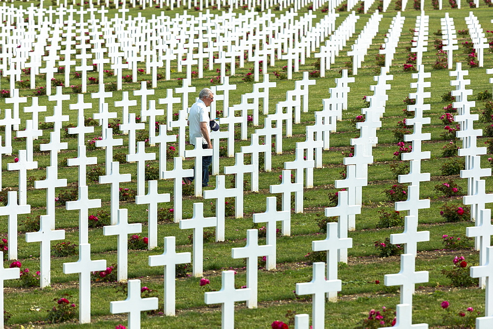 Man visiting the Cemetery of Douaumont (Ossuaire de Douaumont) at Fleury-devant-Douaumont near Verdun, Meuse, Lorraine, France, Europe